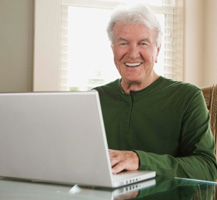 older man with laptop